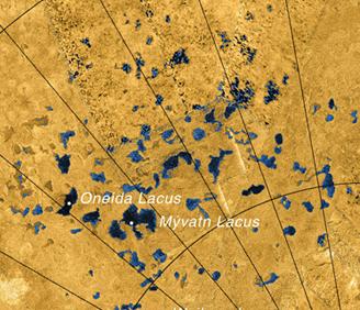 "Alleged ""sinkhole"" lakes in the flat plains of Titan's polar region. (Cassini/NASA)"