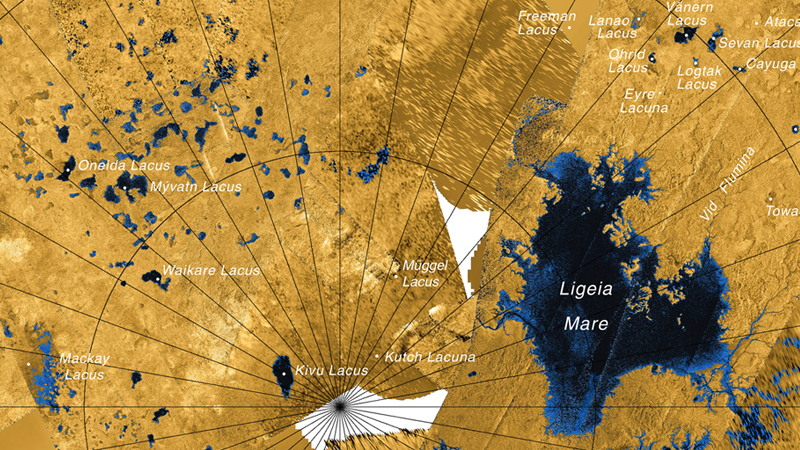 "Radar map of the polar region of Saturn's moon Titan. A river-system-fed sea is seen on the right, and the complex of alleged ""sinkhole"" lakes to the left. (Cassini/NASA)"