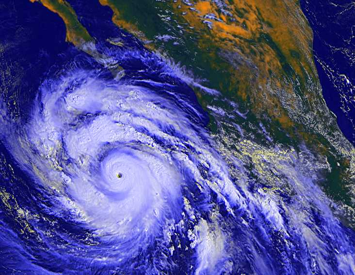 Hurricane Linda roars past Baja California, spreading upper-level moisture far to the north.