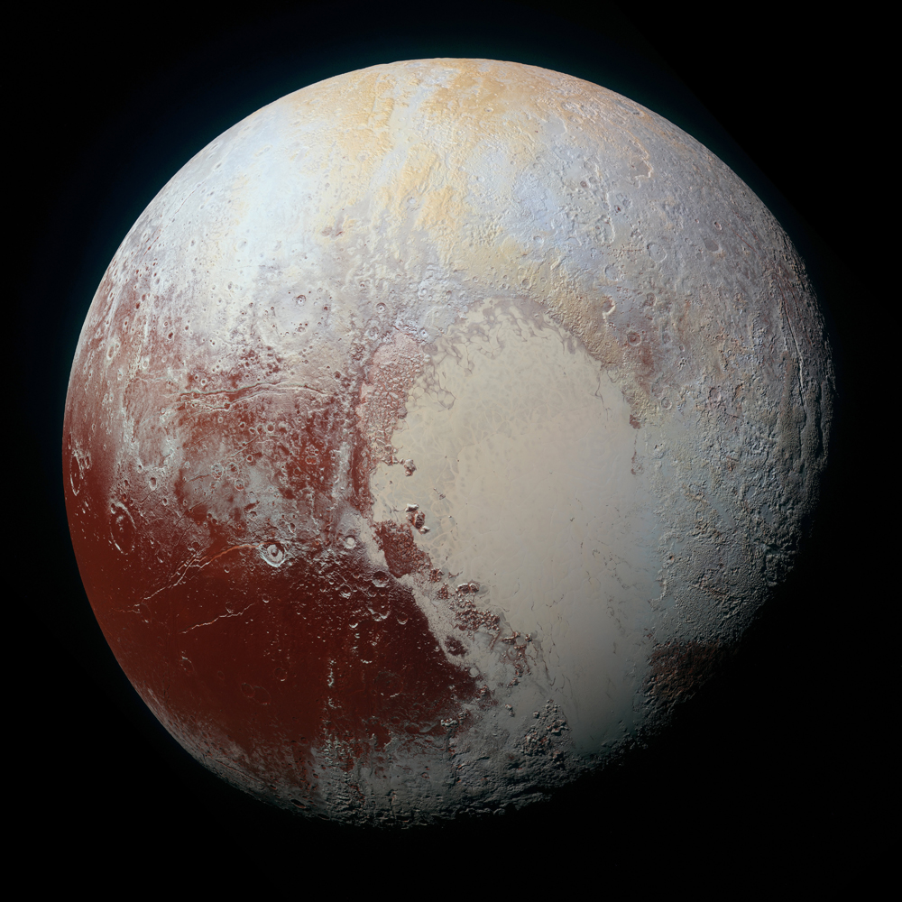 New Horizons' high-resolution color-enhanced portrait of Pluto, exaggerated colors showing variations in surface composition and terrain.