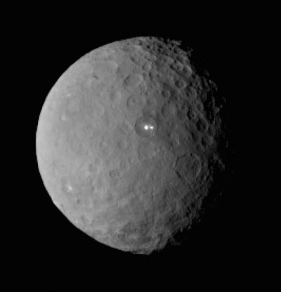 Early images of Ceres' mysterious white spots showed them as little more than bright, featureless dots.