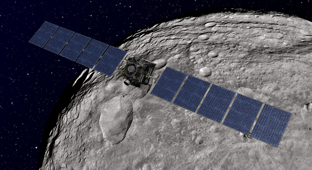 Artist concept of NASA's Dawn spacecraft orbiting the dwarf planet Ceres.