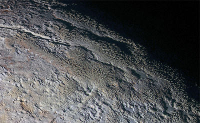 "A bizarre and unexplained surface terrain on Pluto dubbed ""snake-skin."""
