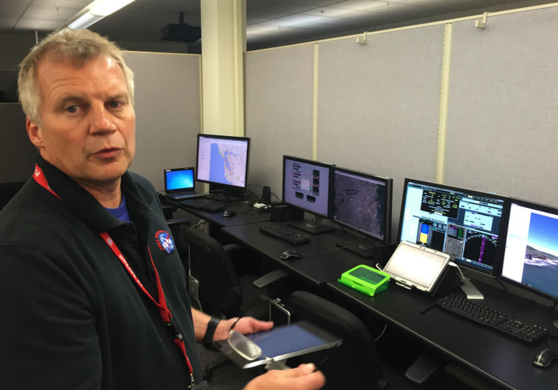 NASA engineer Tom Prevot shows computer screens simulating a sky full of drones. Technology he's building will manage their flight plans.