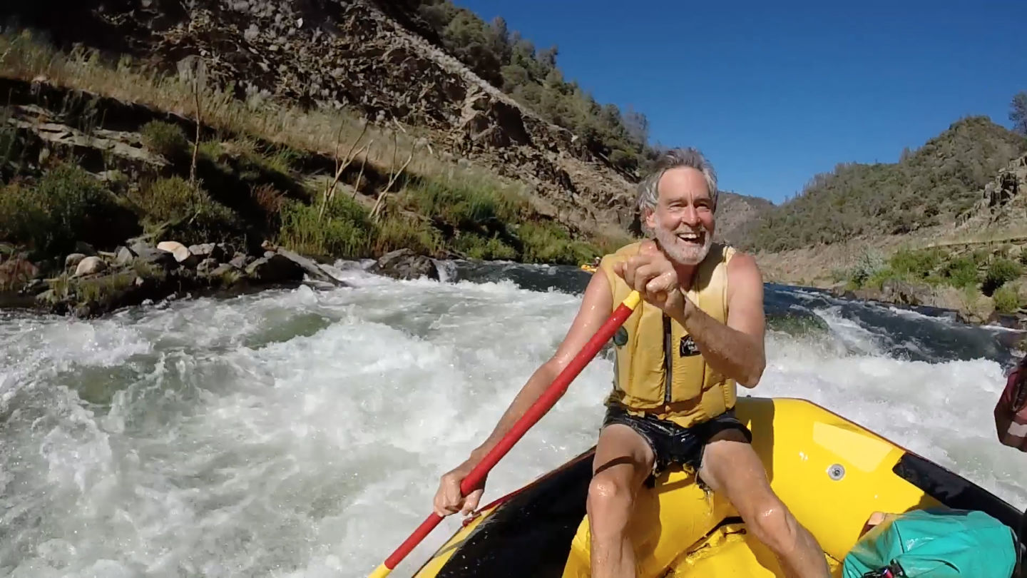Mark Dubois rafting the Stanislaus for the first time in more than three decades. Dubois is considered an icon among river advocates. Craig Miller/KQED