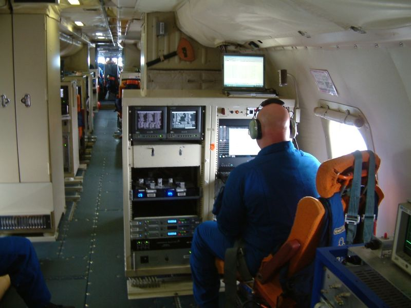 Research cubicles line the length of the plane, where scientists monitor variables like water vapor, wind direction and air pressure.