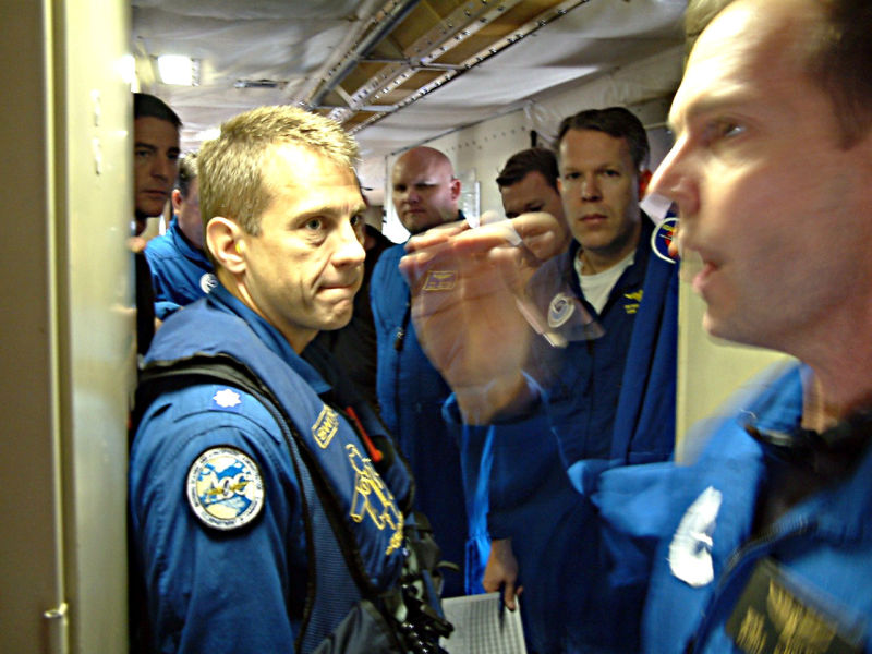 The Hurricane Hunter crew debriefs after a research flight.
