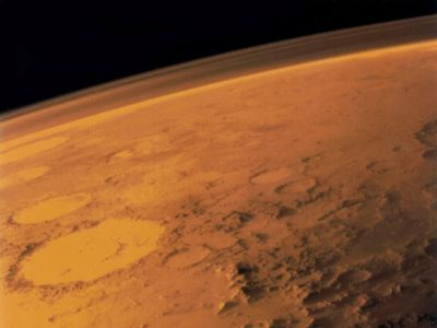 Mars' dry cratered surface and thin atmosphere imaged by the Viking 1 orbiter.