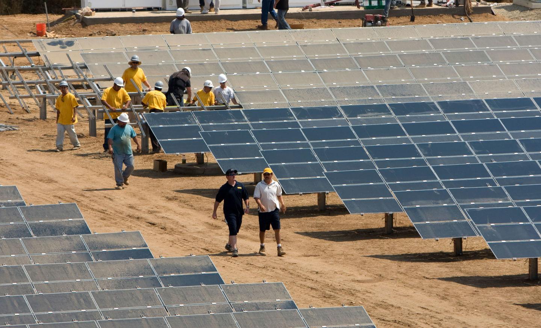 Workers install a solar farm outside Sacramento.
