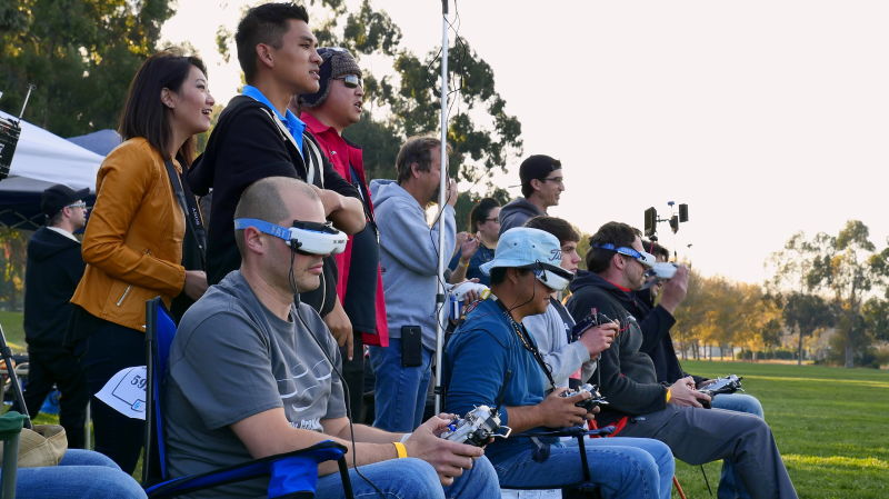 Spectators look on as drone pilots race their drones around a course at Baylands Park in Sunnyvale.