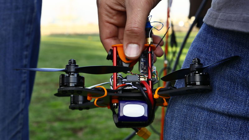 The drones used for racing are small, typically under a pound, and built using parts such as motors, a small camera and a flight controller.