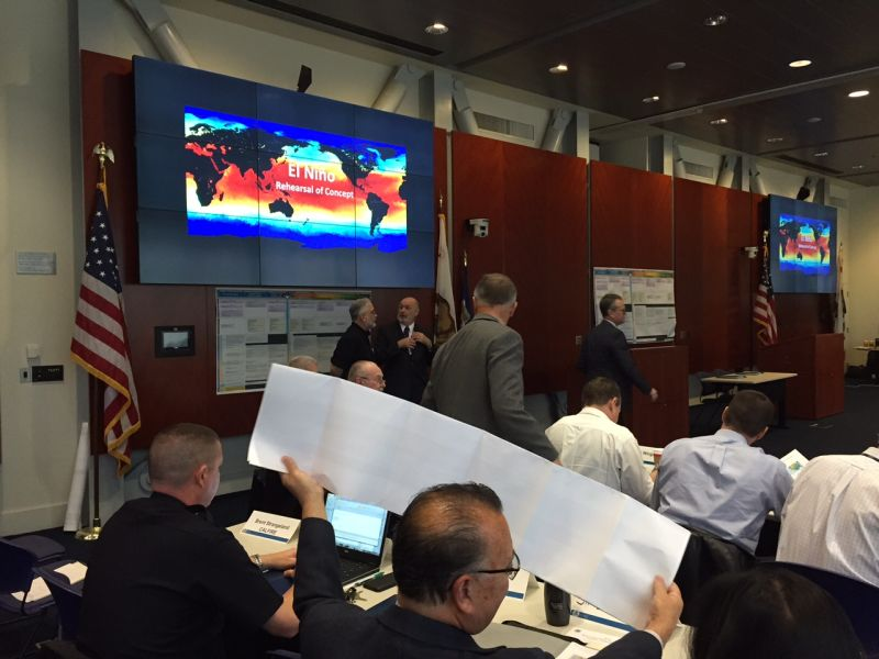 Government officials gather at the California Office of Emergency Response during an El Nino disaster response planning session.