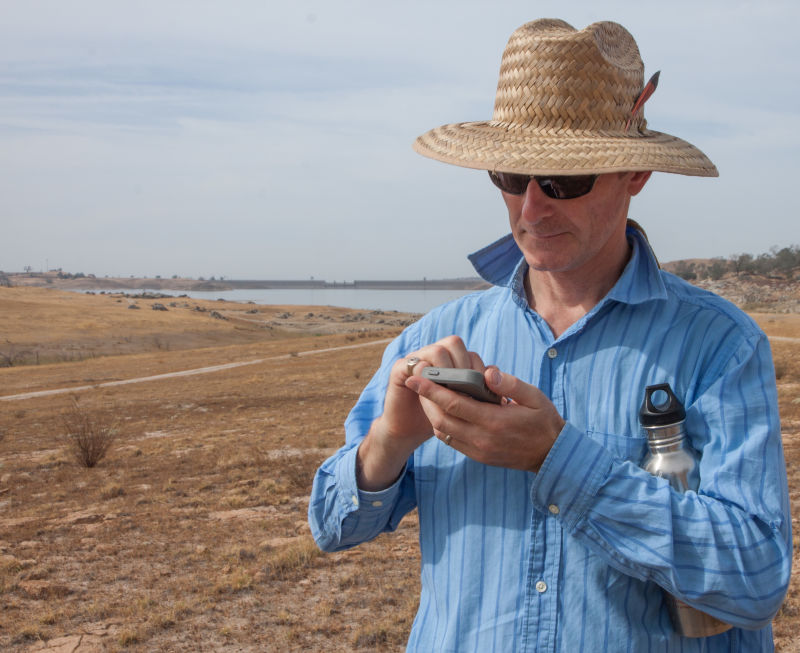 Pluhar consults a mapping app to find the contact between two rock layers.