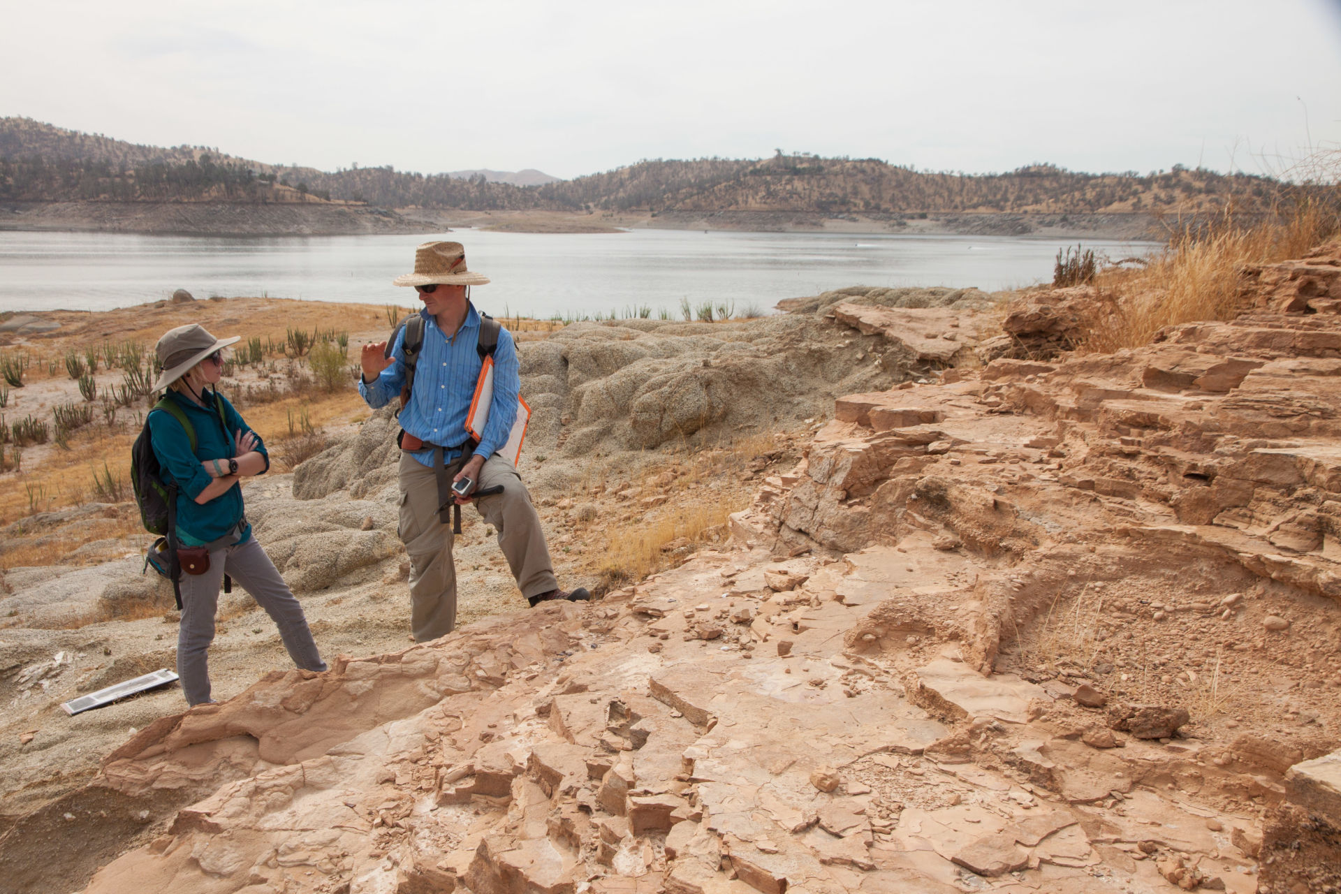 Freso State geologist Chris Pluhar and his student Wynter Erickson hope these rocks, normally underwater in Millerton Lake, will reveal clues about the geological history of the Sierra Nevada.