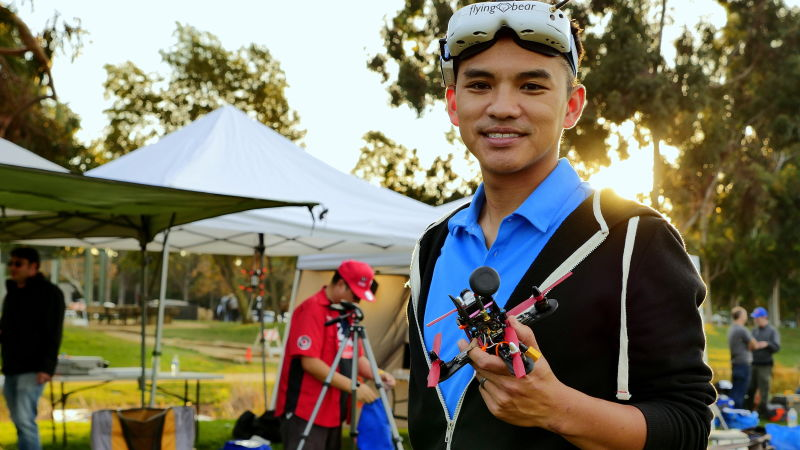 Ken Loo shows off his drone at a drone racing competition he organized and competed in at a park in Sunnyvale.