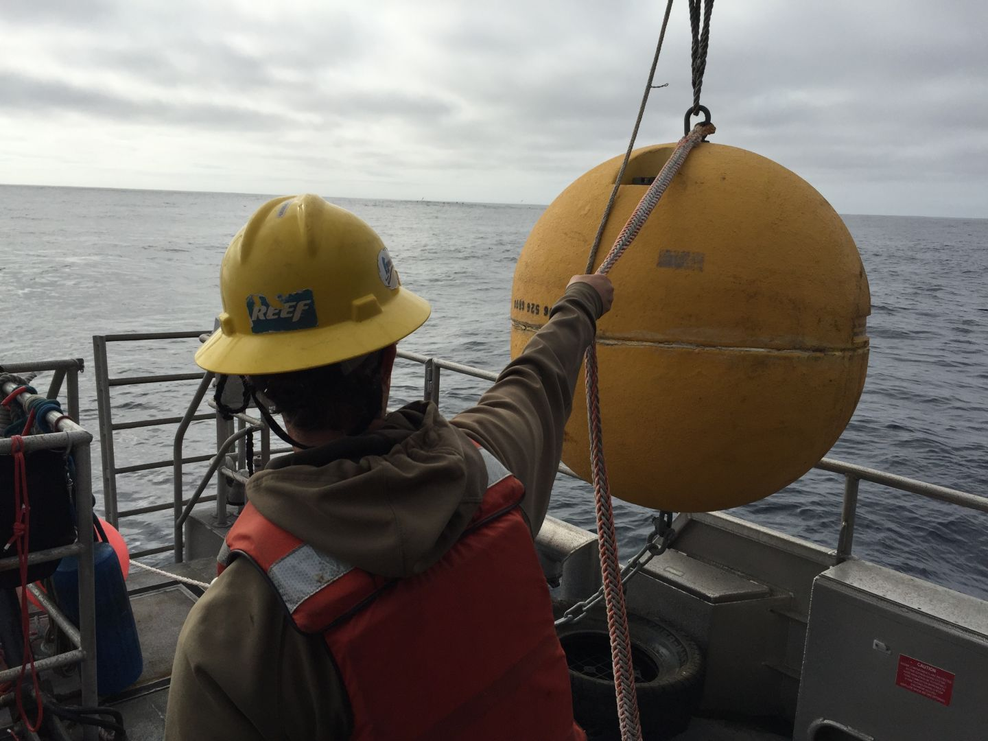 Technician Dale Hubbard, with NOAA scientists aboard the R/V Fulmar, prepares to deploy an undersea sound-recording station 20 miles off of Pt. Reyes, in the Cordell Bank Nat'l Marine Sanctuary.