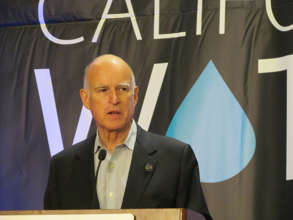 Governor Jerry Brown addresses a water conference in Sacramento.