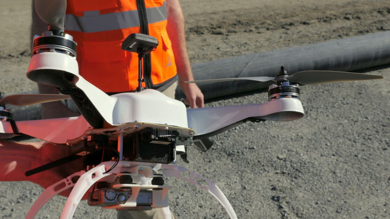 A drone built and operated by Skycatch is about to take off on an aerial survey of a rock quarry in San Rafael.