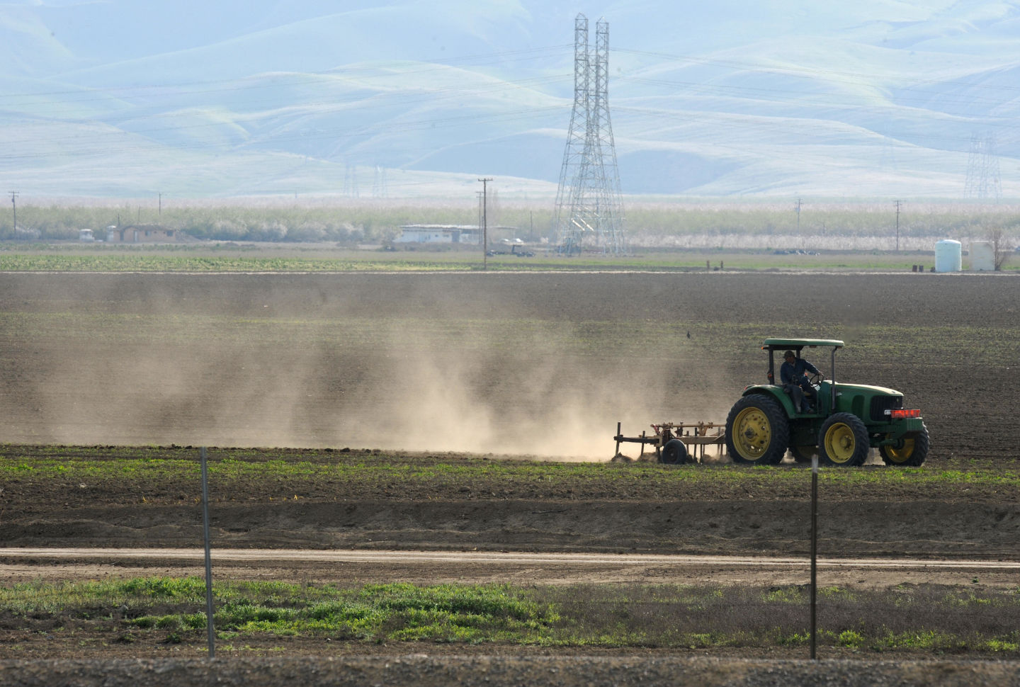 A farmer plows a field in Mendota, California in the San Joaquin Valley. Due to drought conditions many farmers do not have enough water to plant their fields.