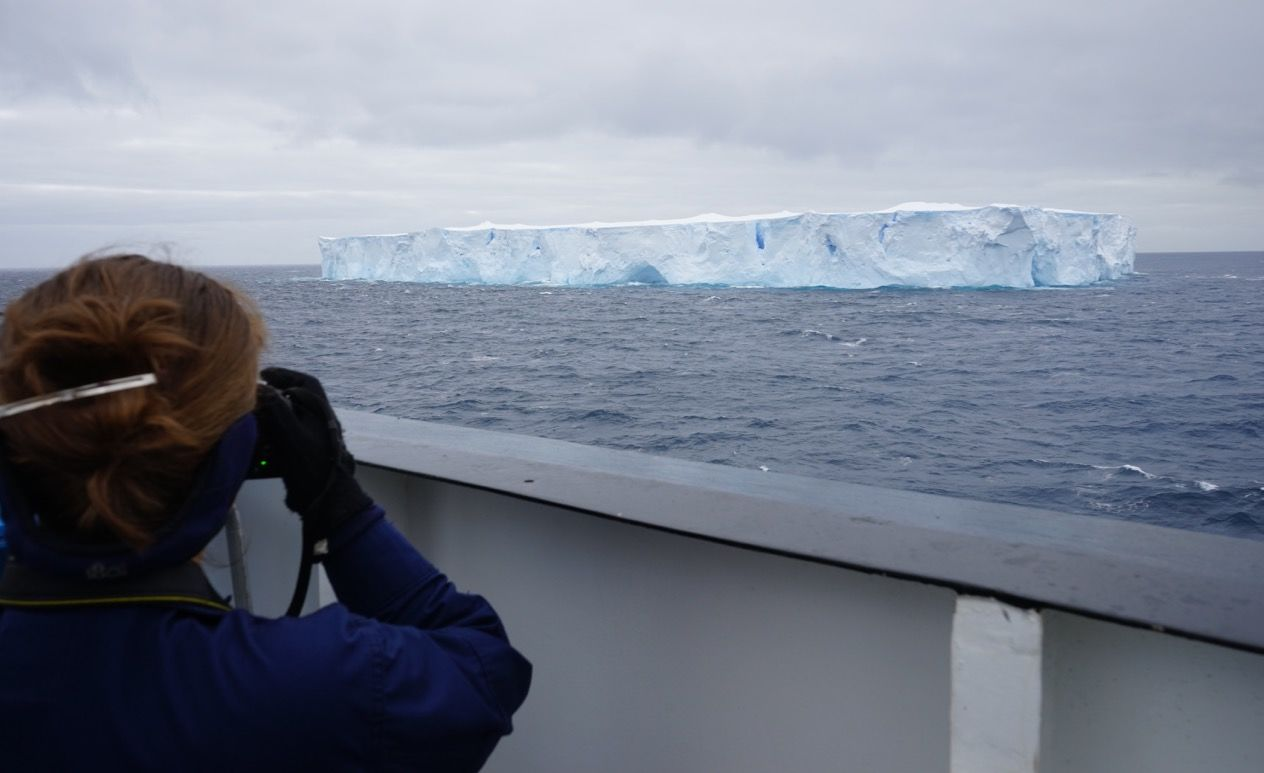 Executive Officer Cdr. Mary Ellen Durley snaps photos of a quarter-mile-long tabular iceberg. This one's considered to be on the smaller side.