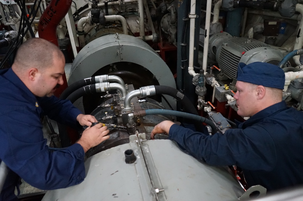 Chief Keith Hoeffer and Petty Officer Keith Bryan work on repairs to the propulsion system. Breakdowns are a way of life in the ice.