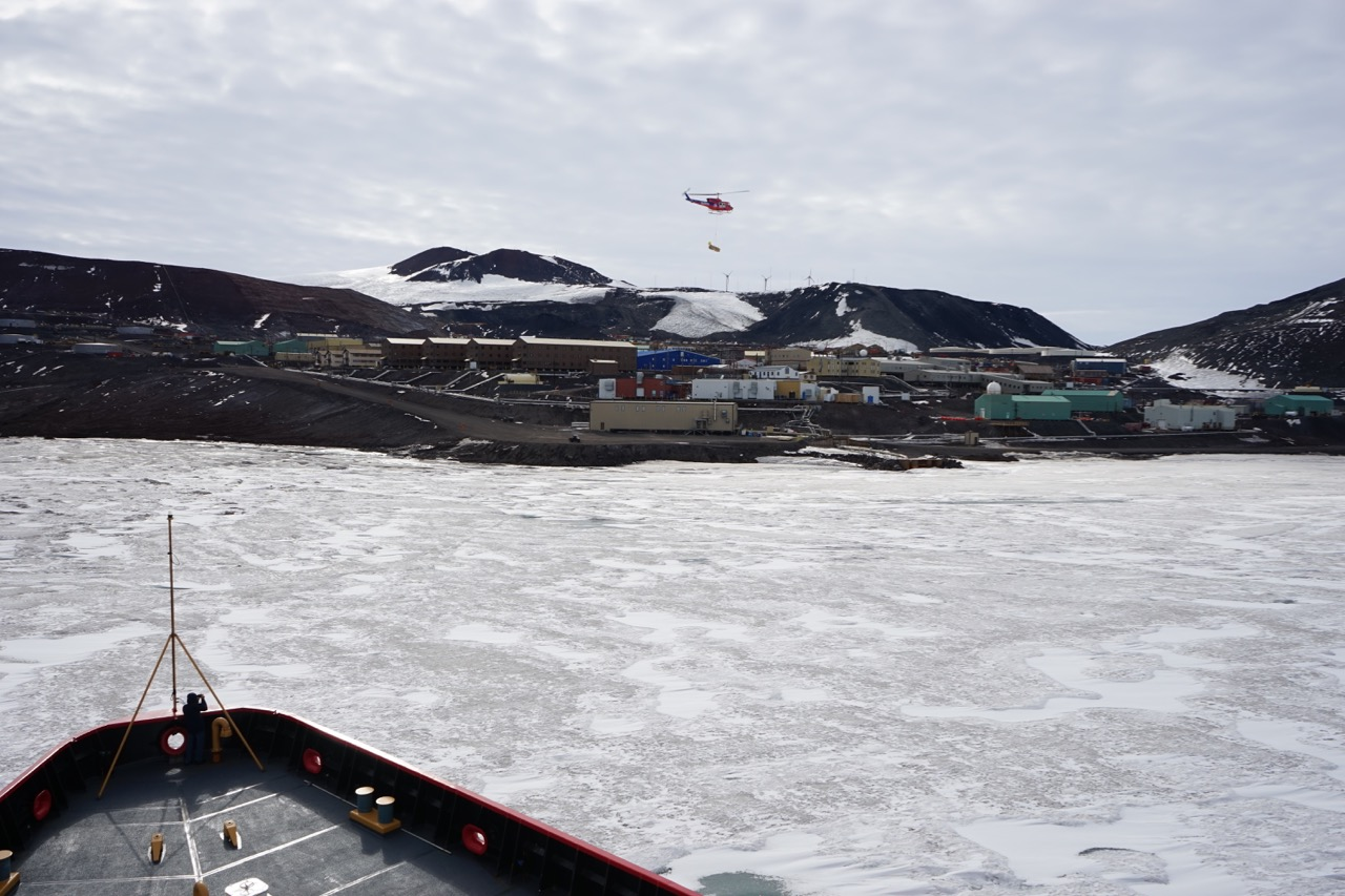 Polar Star approaches the icebound McMurdo research station on Ross Island, Antarctica.