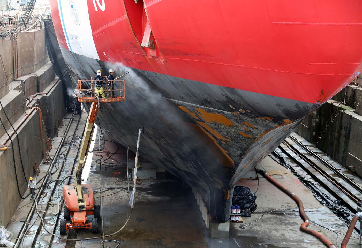 This view of Polar Star in dry-dock reveals the specially-shaped keel for riding up onto heavy ice.
