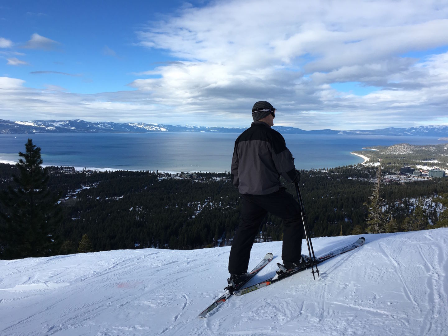 A skier surveys the view of South Lake Tahoe from Heavenly ski resort.