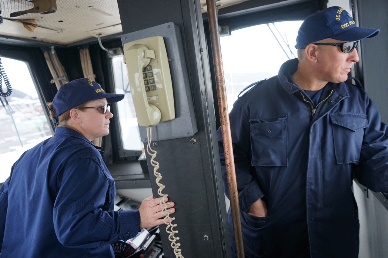 Executive Officer Cmdr. Mary Ellen Durley and Capt. Matt Walker look back at the turning basin as Walker breaks Polar Star into the pier at McMurdo Station.