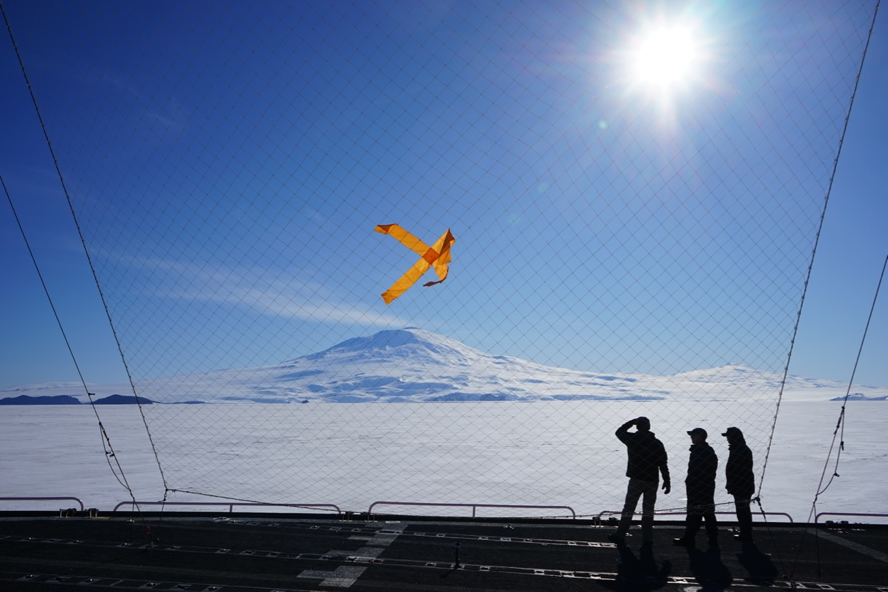 Aerovironment's Kevin Volbrecht and NOAA Corps' Lt. Junior Grade Casey Marwine and Lt. Carl Rhodes spot the Puma in front of the net designed to snag it at the end of its flight.