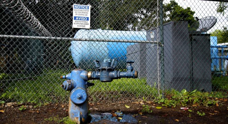 A sign warns not to drink the water at the Gloria Way well in East Palo Alto. The city hopes in 2017 to begin construction on a new well here to use groundwater to augment water supply.