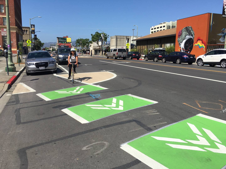 A cyclist cruises down a new dedicated bike lane on Telegraph Avenue in Berkeley.  Andrea Kissack/KQED