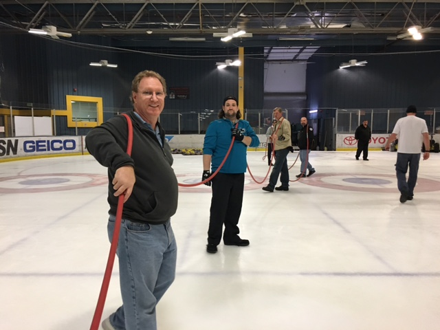 Bay Area curlers flood the ice at the Sharks Ice Facility in Fremont during a course with Jamie Bourassa, one of the world's best curling ice technicians. They need to make the surface as level as possible for the curling tournament.