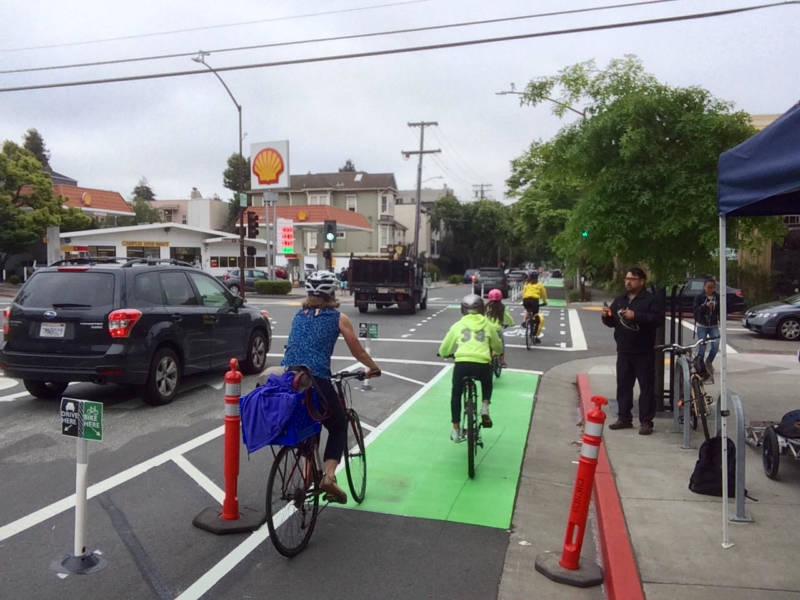Flexible posts block traffic from driving into a new protected bike lane in Berkeley.
