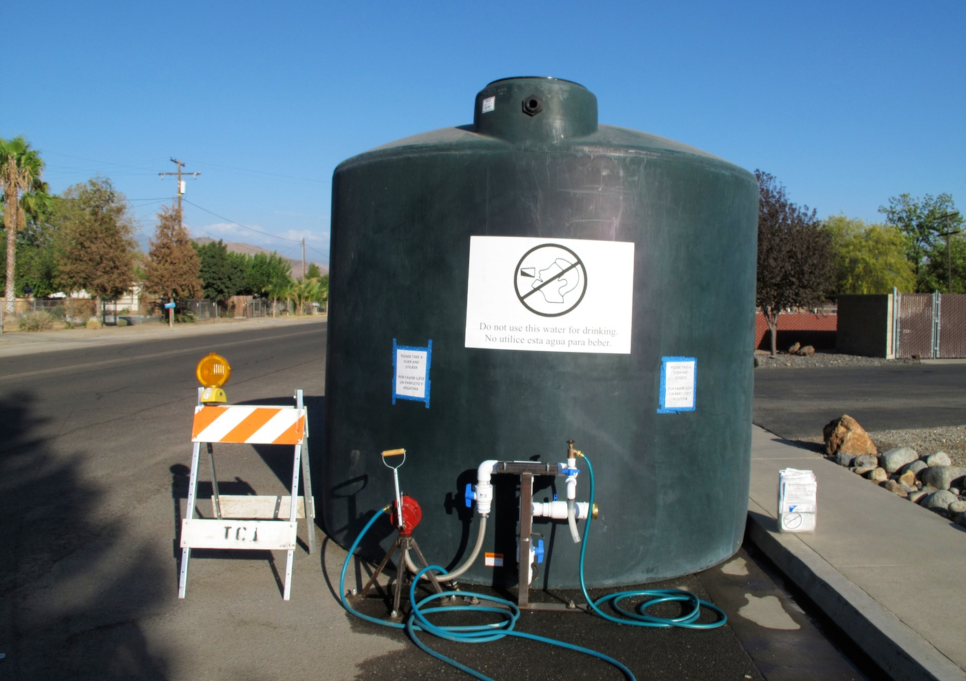 Residents whose wells have run dry can draw water from this 5,000-gallon (18,900-liter) water tank in East Porterville, Calif. The health department recently completed a survey about the impacts of the drought on East Porterville and a neighboring community.