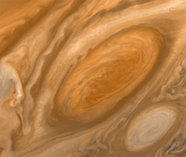 "Jupiter's ""Great Red Spot,"" an anticyclone system that is at least 300 years old and large enough to fit three planet Earths."