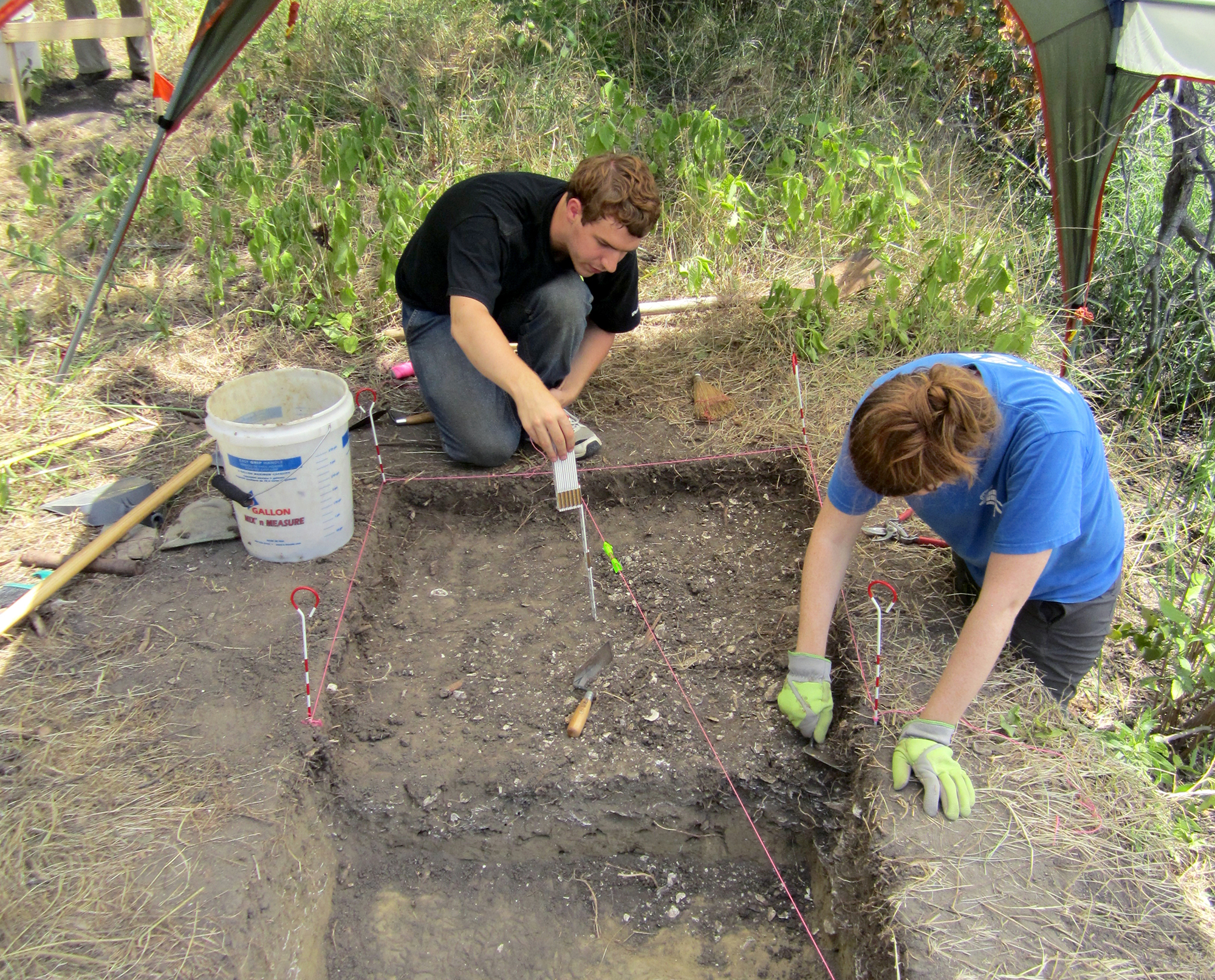 Members of the research team, Sean McCanty and Courtney Hofman, excavate an ancient oyster shell midden at the Smithsonian Environmental Research Center in Edgewater, Md.
