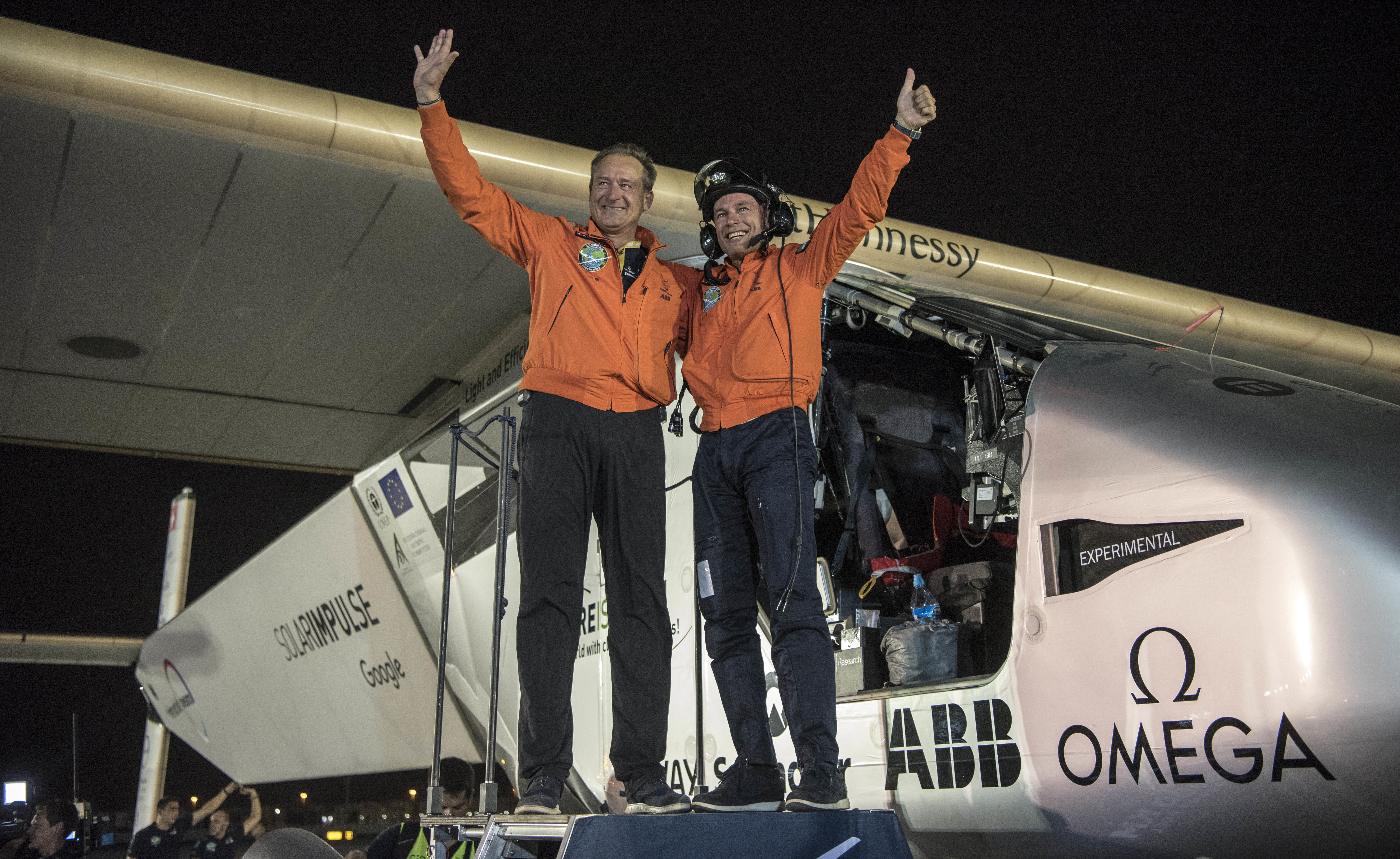 After Solar Impulse's successful landing in Abu Dhabi, the capital of the United Arab Emirates, with Bertrand Piccard at the controls, he posed with fellow pilot Andre Borschberg. The two alternated on 23 days' worth of flights without using any fuel.