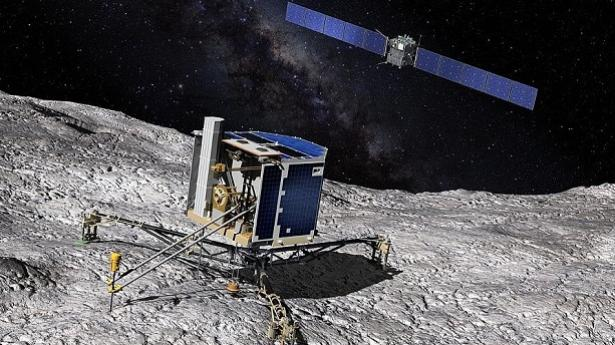 Artist concept of the Philae lander on the surface of comet 67P/Churyumov-Gerasimenko, with the Rosetta spacecraft in the background.