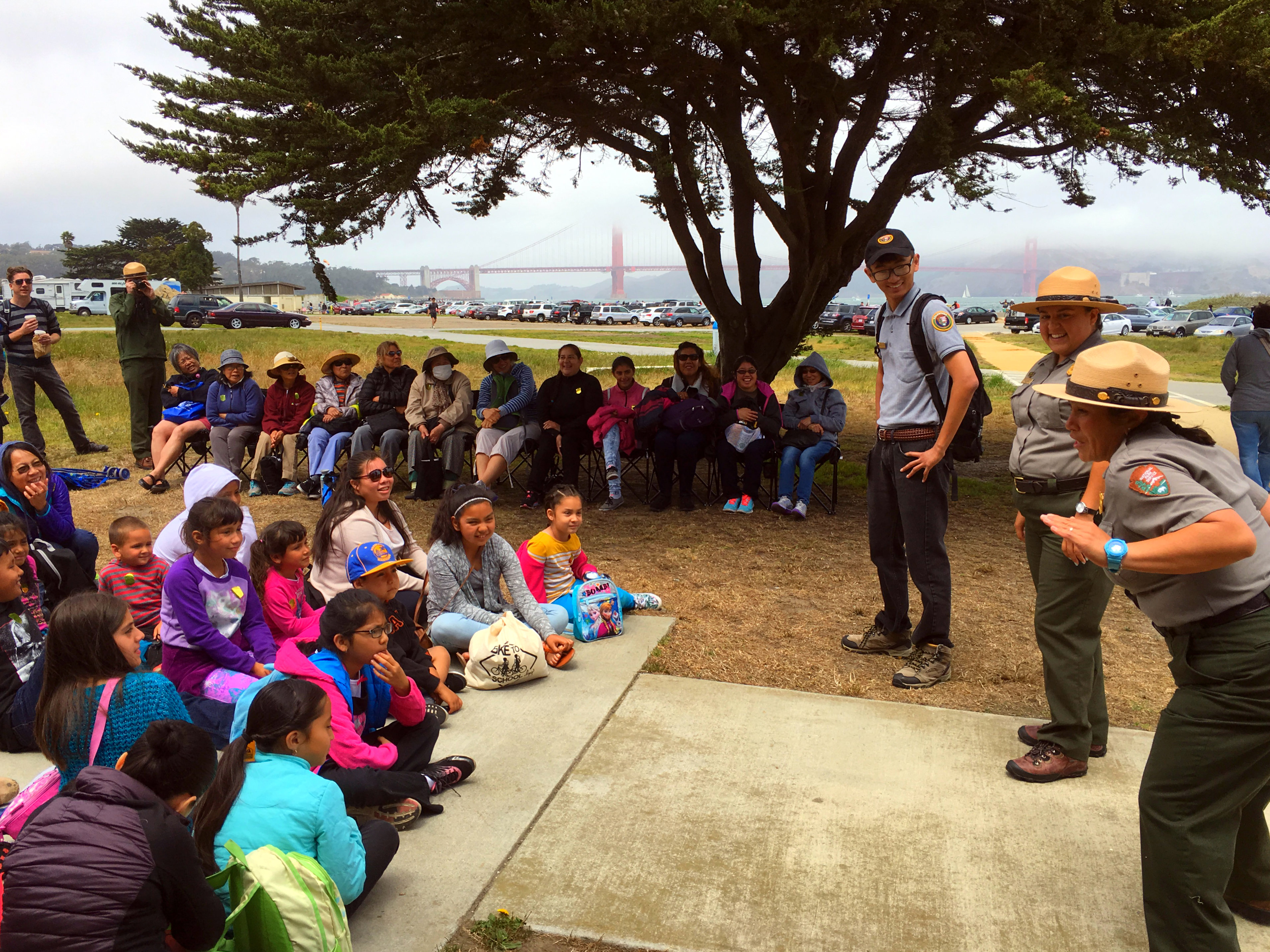 Park rangers explain flora and fauna at Chrissy Field to a group of visitors from the Mission District who took free shuttles to Chrissy Field.
