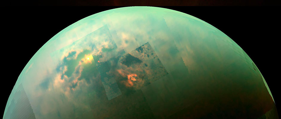 Flashes of sunlight reflecting off of a sea of liquid hydrocarbon on Titan, glimpsed by Cassini through Titan's thick layers of atmospheric haze.