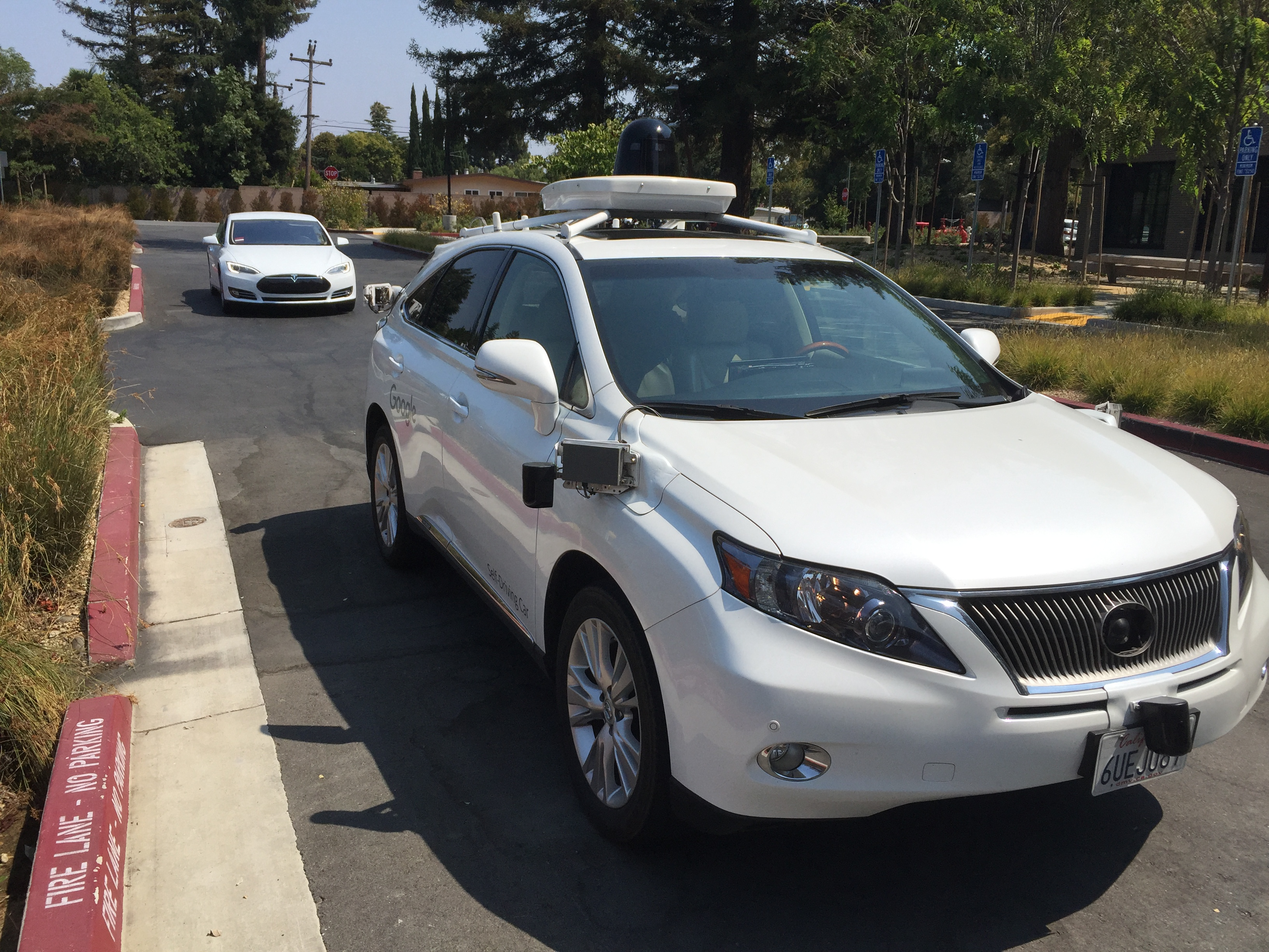 Google has more than fifty experimental self-driving cars on the road. About half are like this one – a modified Lexus RH450H – while the rest are small prototype test vehicles that don't have steering wheels.