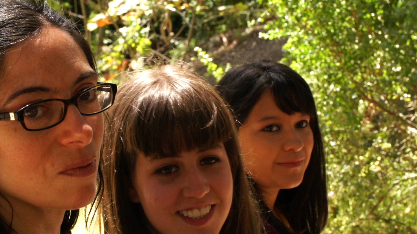 Mikel Delgado, Amanda Robin and Breana Martinez take a break from studying fox squirrels on the University of California, Berkeley, campus.