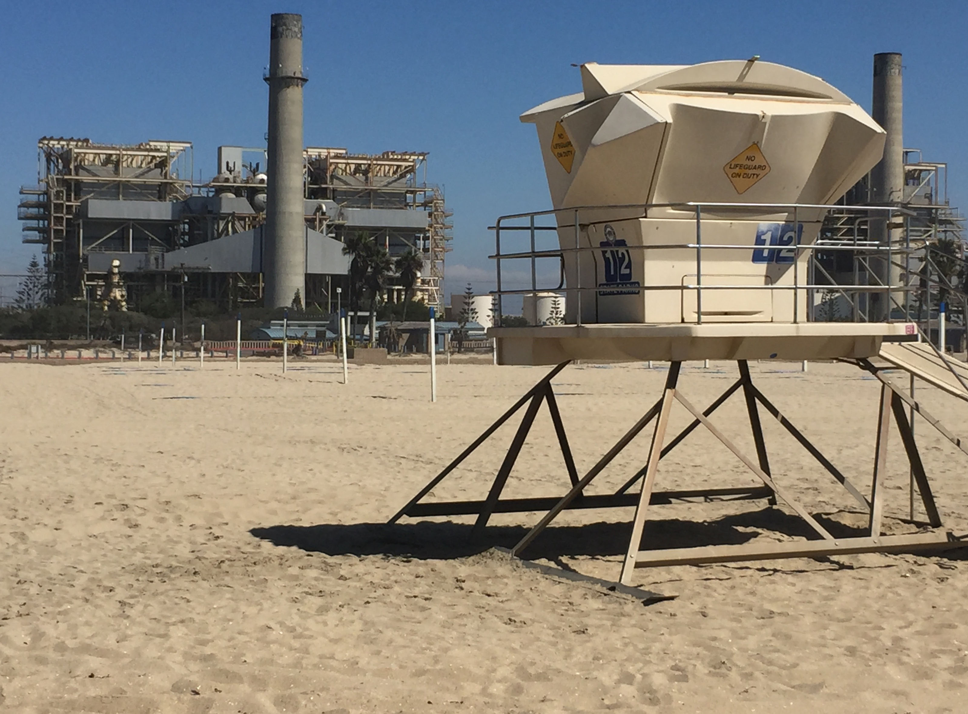 The proposed Huntington Beach desal plant would use the outflow pipe from the AES power plant (background) to deposit salt residue, known as brine, back into the ocean.