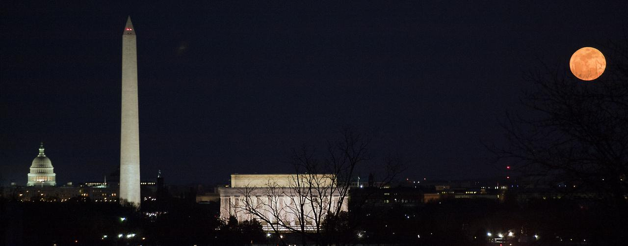 """A """"super moon"""" rises near the National Mall in 2011, in Washington D.C. The full moon is called a super moon when it is at its closest to Earth. Paul E. Alers/NASA"""