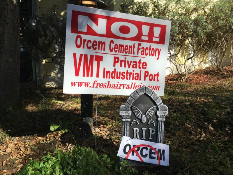 Protest signs are staked into many yards or pasted into windows throughout Vallejo.