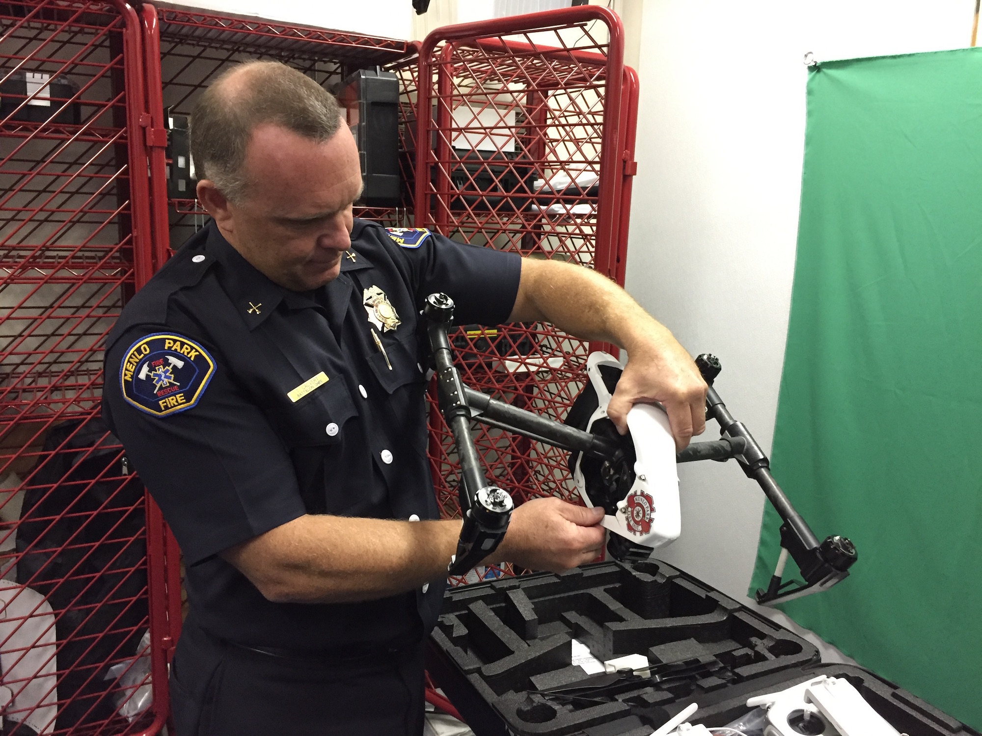 Menlo Park Battalion Chief Tom Calvert inspects one of his department's drones. The fire district has two certified pilots so far.