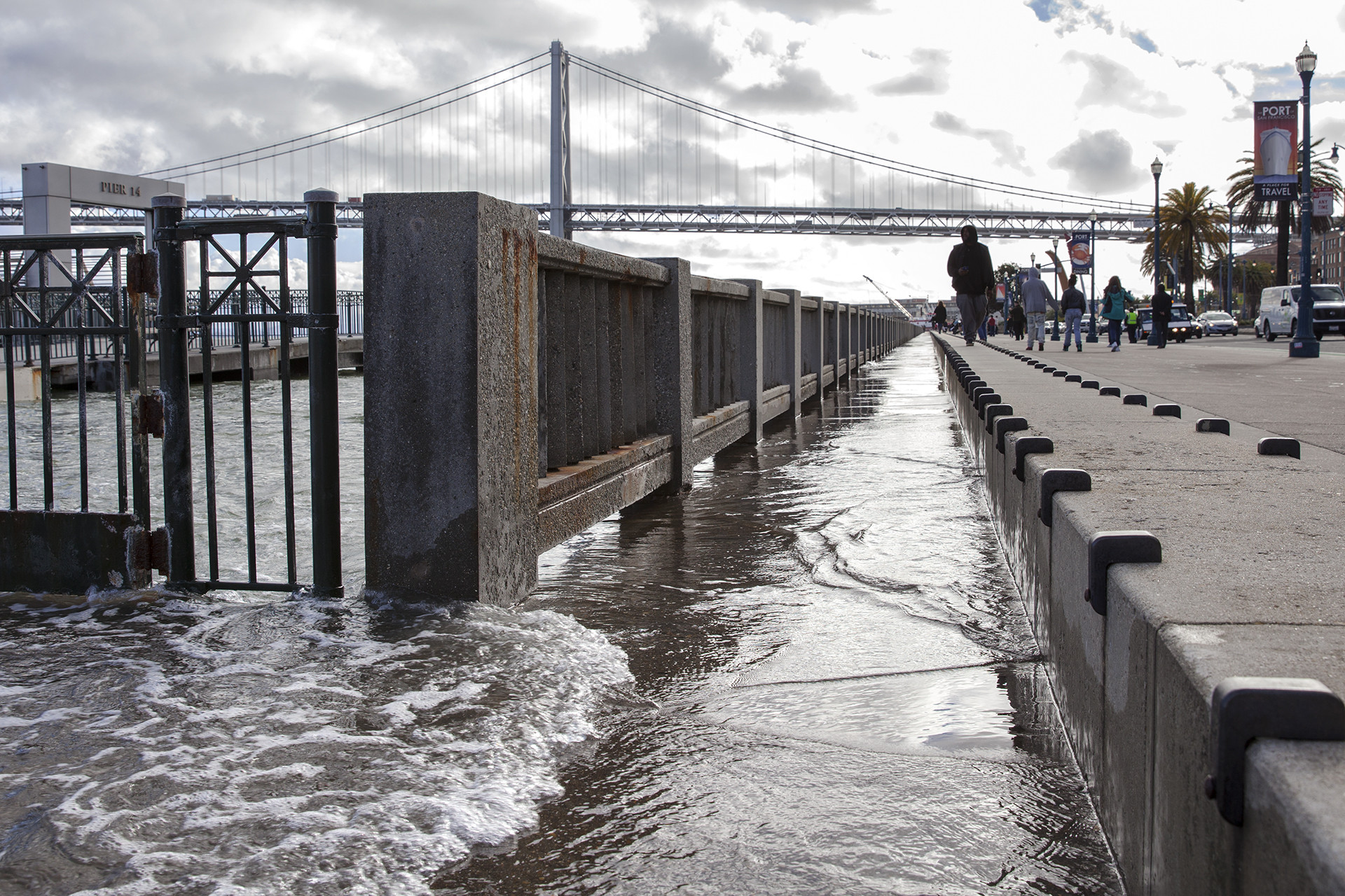 Walkways along Pier 14 at the San Francisco Embarcadero begin to flood during the high point of a king tide on January 11, 2017.