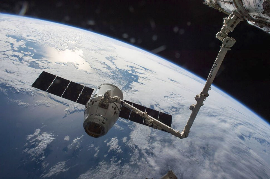 """SpaceX Corporation's """"Dragon"""" space capsule, currently operating as an un-crewed cargo vessel to supply the ISS. SpaceX is also developing a crewed version, """"Dragon 2""""."""
