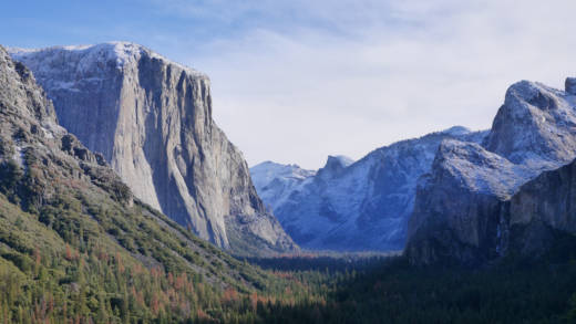 The first snow of winter coating El Capitan and the surrounding mountains in Yosemite National Park, California.